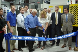 Mike and Lynda Bechtold cutting grand-opening ribbon