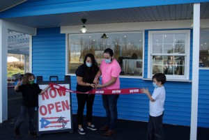 From l to r: Sergio, Neymaris, Andrew and Vincent helping cut the ribbon to Mamia's Island