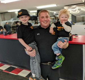 Tony Caraglio holding his sons, AJ on left and Mikey on right.