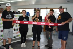 Amy DeMay, owner, cutting the grand-opening ribbon at Grantley's Bait and Tackle